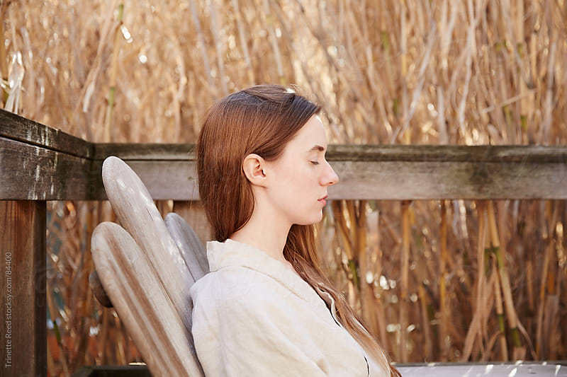 Relaxed redhead young woman wearing linen robe in nature by Trinette Reed for Stocksy United