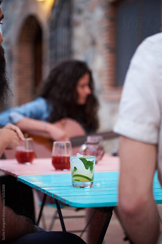 Close-up of fresh mojito on table by Guille Faingold for Stocksy United