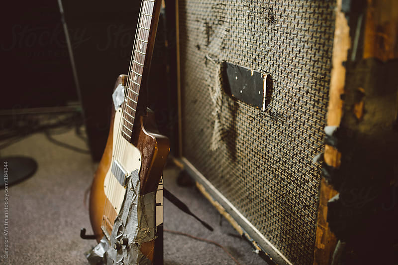 Punk rock guitar and amp  by Cameron Whitman for Stocksy United