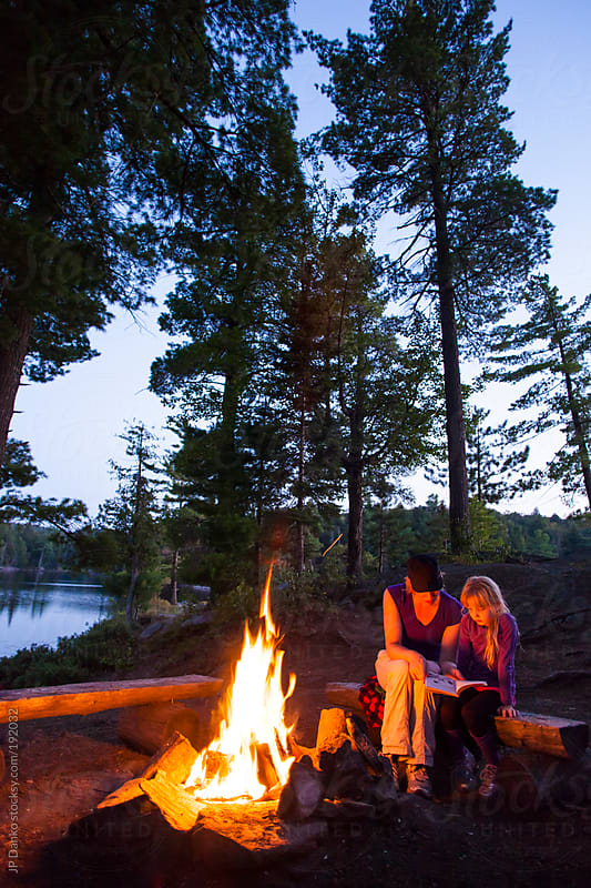 Mother Reading Camp Fire Story To Little Girl by JP Danko for Stocksy United