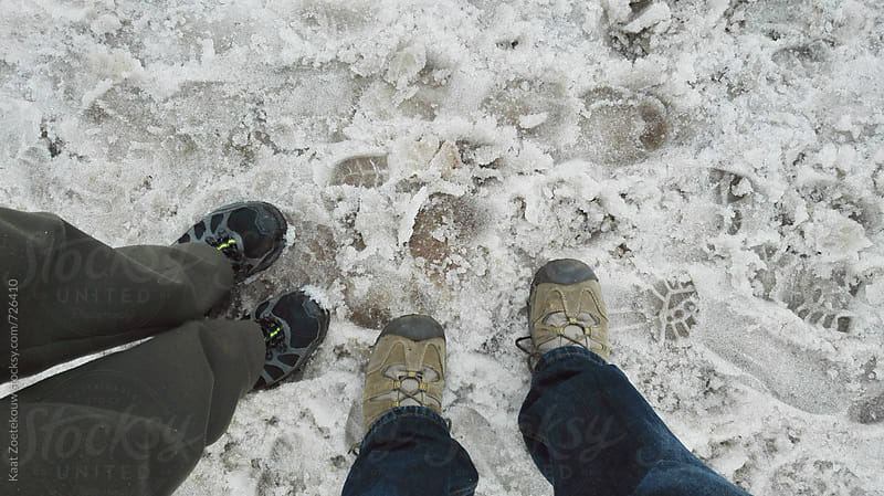 Hikers' shoes on snowy trail, Norway by Kaat Zoetekouw for Stocksy United
