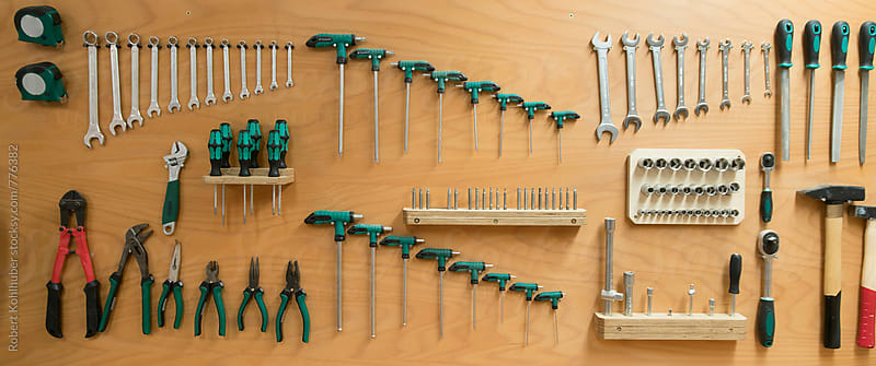 Tools hanging on wall by Robert Kohlhuber for Stocksy United