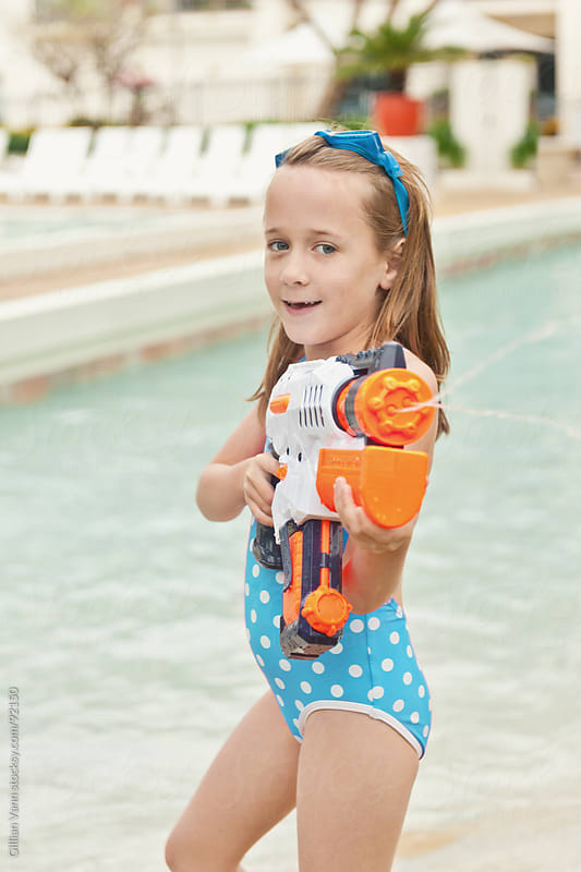 watergun girl by Gillian Vann for Stocksy United