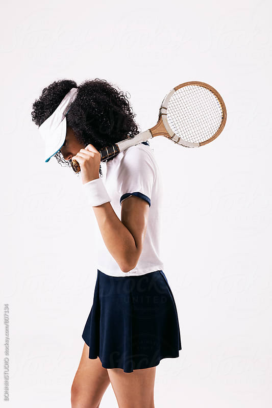 Side view of a woman wearing fashion sport clothes. Tennis by BONNINSTUDIO for Stocksy United