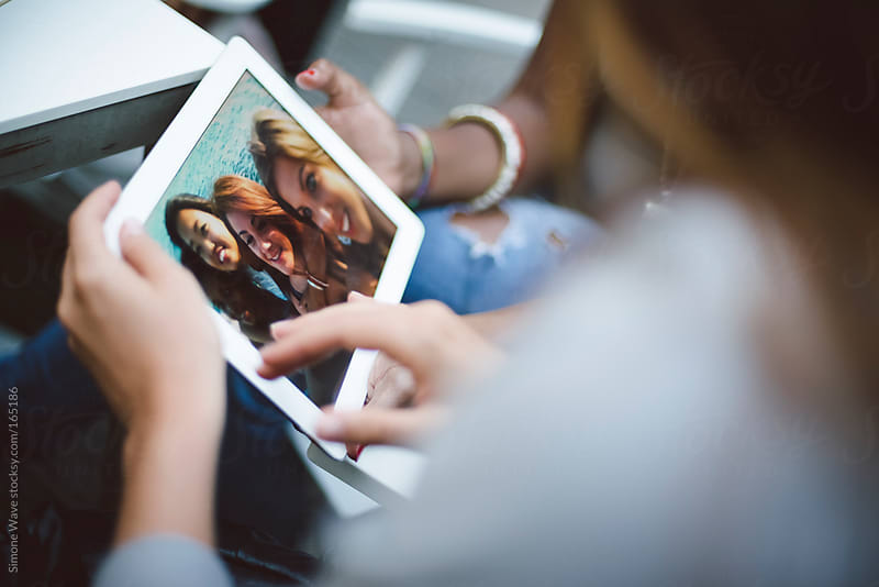 Teenager during a videochat with tablet by GIC for Stocksy United