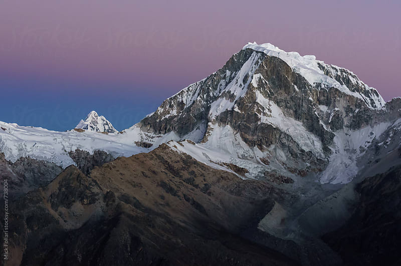 Alpenglow and high altitude peak in the Andes by Mick Follari for Stocksy United
