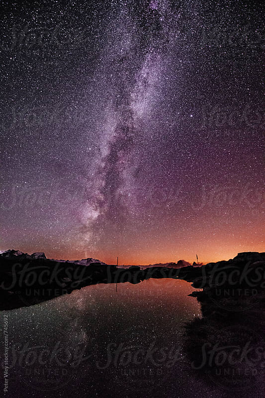 Mountain lake with galaxy by Peter Wey for Stocksy United