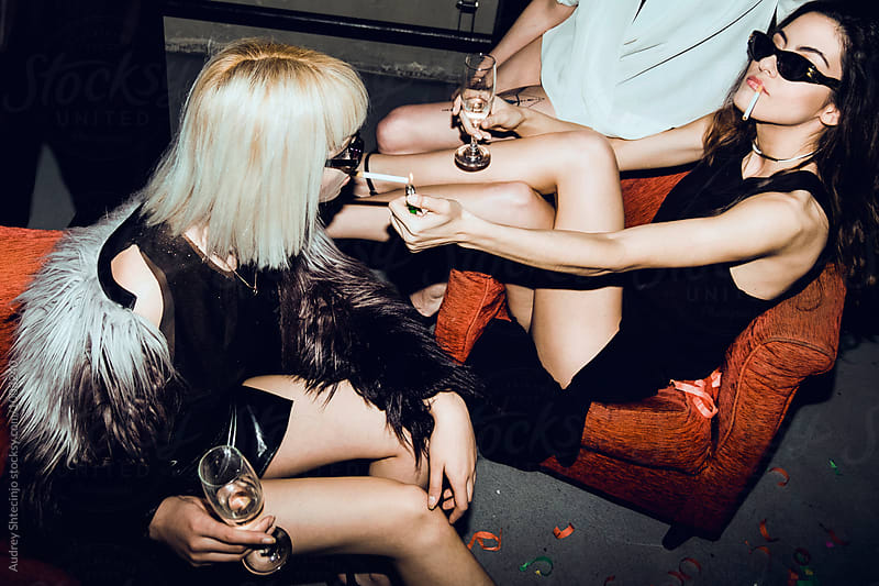 Female fashionable models at private party. by Audrey Shtecinjo for Stocksy United