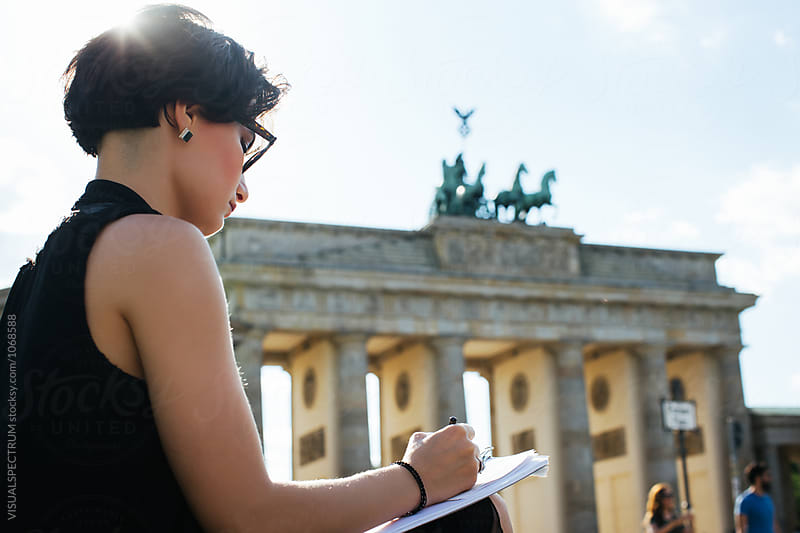 Profile of Young Artist Drawing Outdoors Near Brandenburg Gate by Julien L. Balmer for Stocksy United