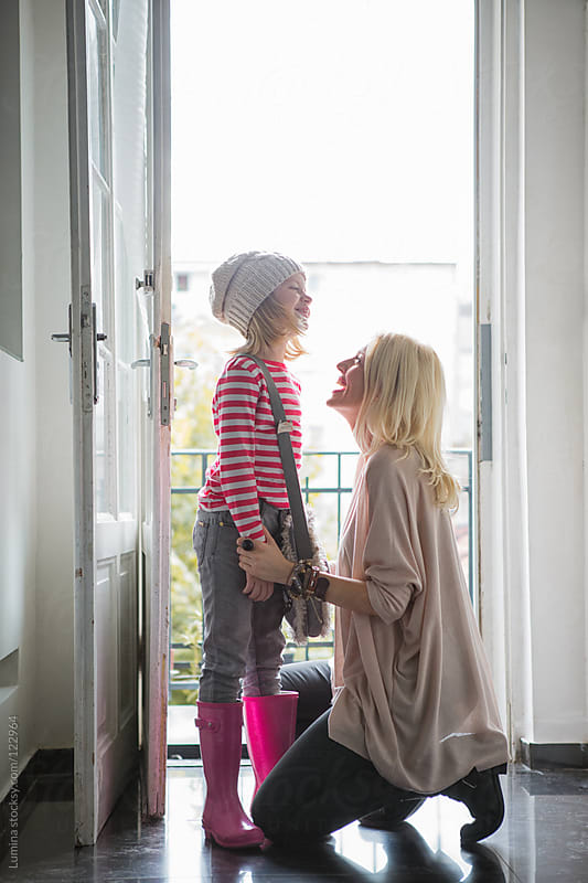 Mother Seeing Her Daughter Off to School by Lumina for Stocksy United