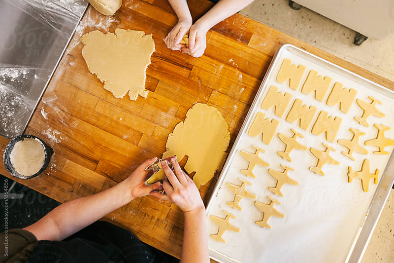 Bakery: Female Bakers Using Cookie Cutter To Make Tray Of Cookies by Sean Locke for Stocksy United