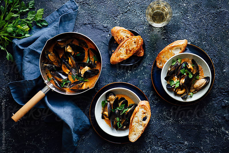 Mussels in curry sauce  by Ellie Baygulov for Stocksy United