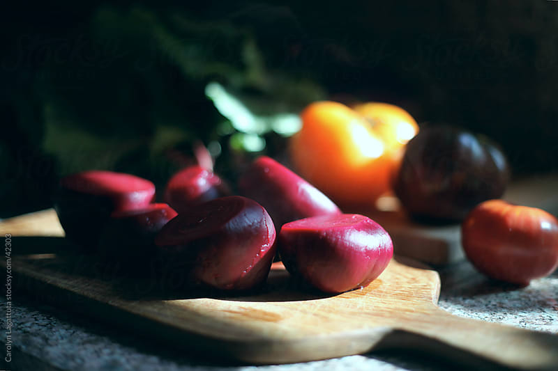 Organic beets and multi-colored heirloom tomatoes by Carolyn Lagattuta for Stocksy United