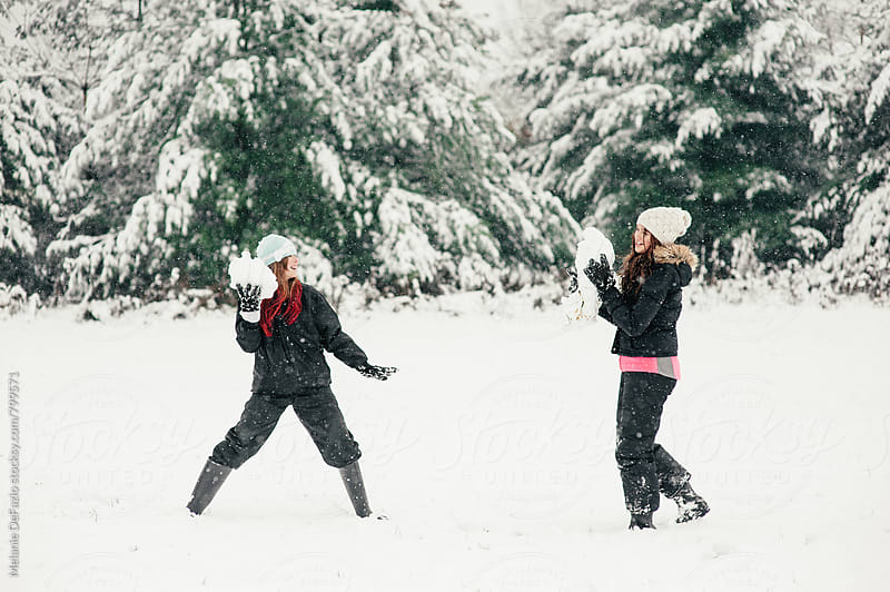 Playing in the snow by Melanie DeFazio for Stocksy United