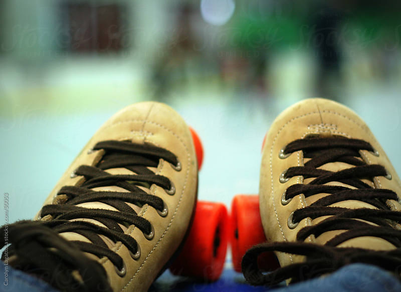 Taking a break from roller skating. by Carolyn Lagattuta for Stocksy United
