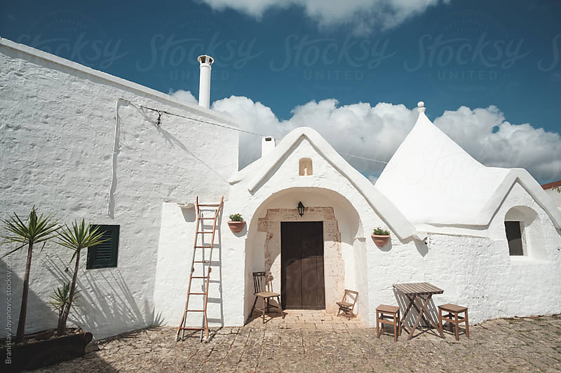 The trulli, the characteristic cone-roofed houses of Alberobello by Branislav Jovanovic for Stocksy United