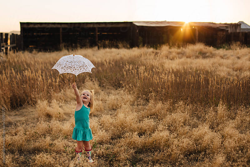 Parasol Fun by Jessica Byrum for Stocksy United