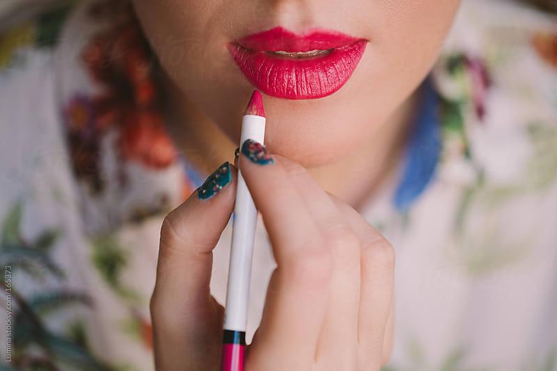 Woman Applying Lipstick by Lumina for Stocksy United