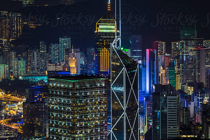 Hong Kong Skyscrapers at Night by Tom Uhlenberg for Stocksy United