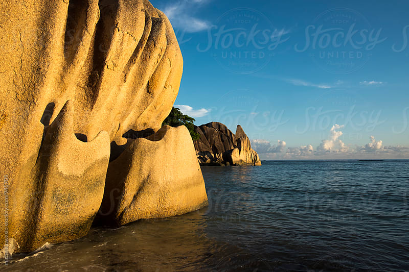 Suggestive granite rocks at sunset, Anse Source D'Argent, La Digue by michela ravasio for Stocksy United