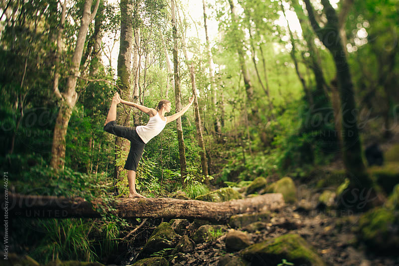 Woman doing yoga in nature by Micky Wiswedel for Stocksy United