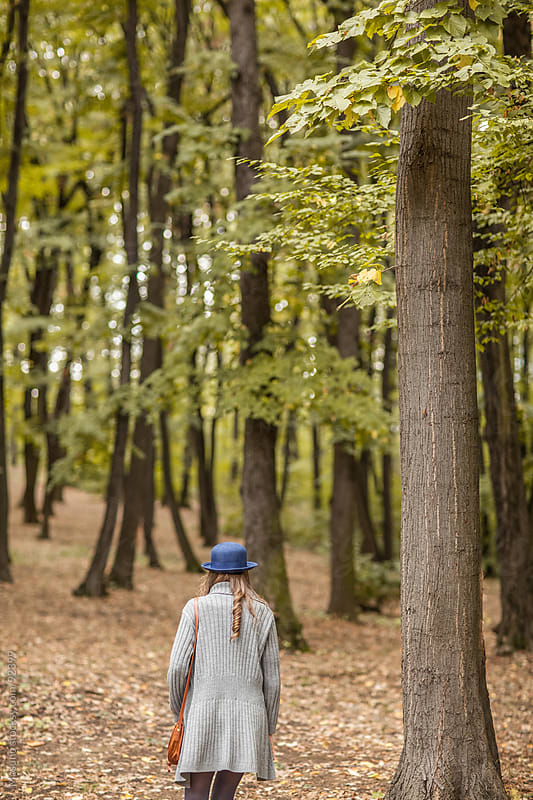 Woman Taking a Walk in a Forest by Mosuno for Stocksy United