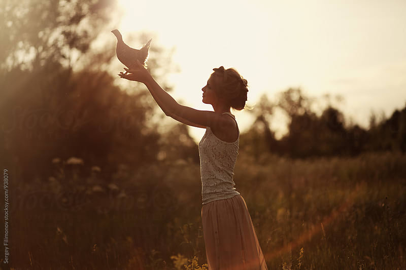 Girl posing at sunset with hazel grouse by Sergey Filimonov for Stocksy United