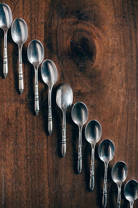 Line of small silver spoons by Vera Lair for Stocksy United