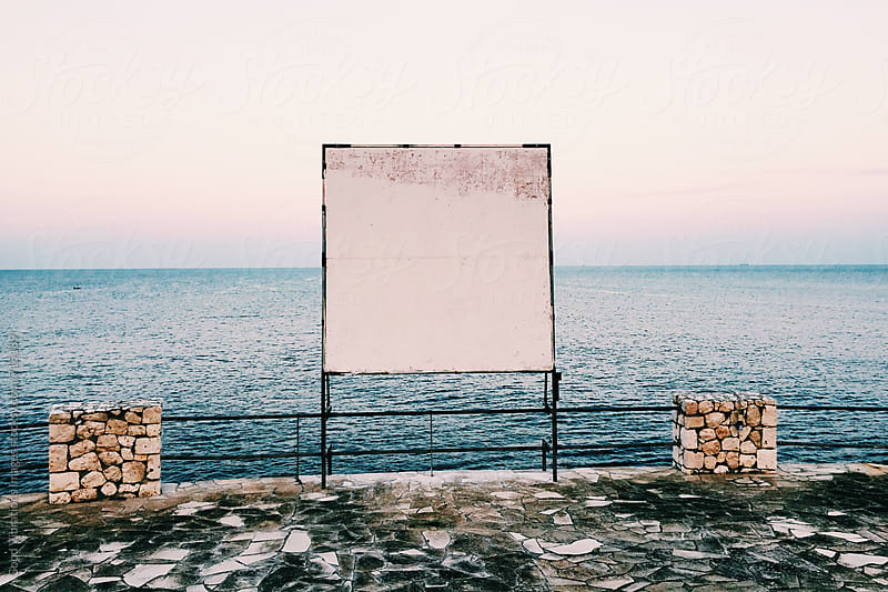 Blank Billboard by the sea at evening by Good Vibrations Images for Stocksy United