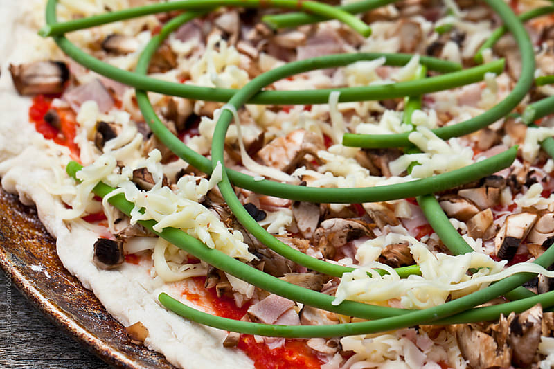 Garlic Scape Pizza by Jill Chen for Stocksy United