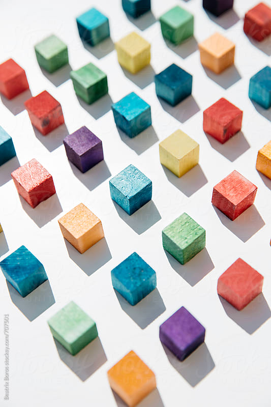 Colored cubes arranged next to each other by Beatrix Boros for Stocksy United