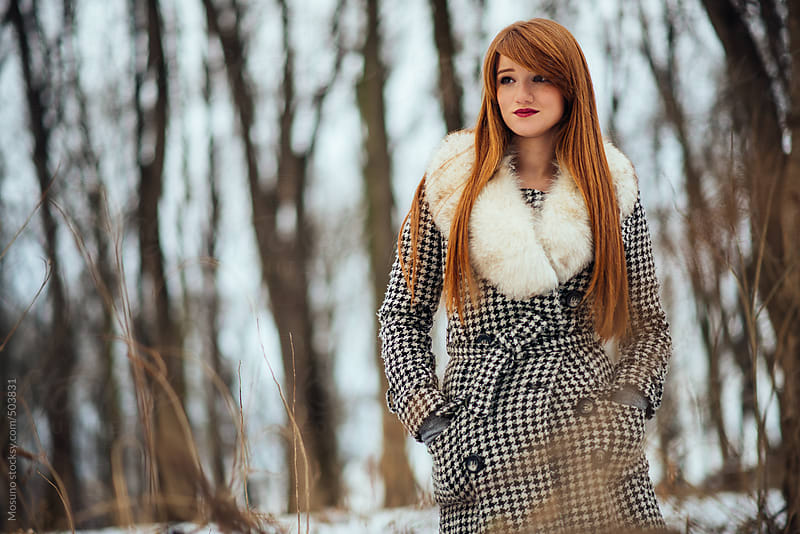 Ginger Woman in a Winter Park by Mosuno for Stocksy United