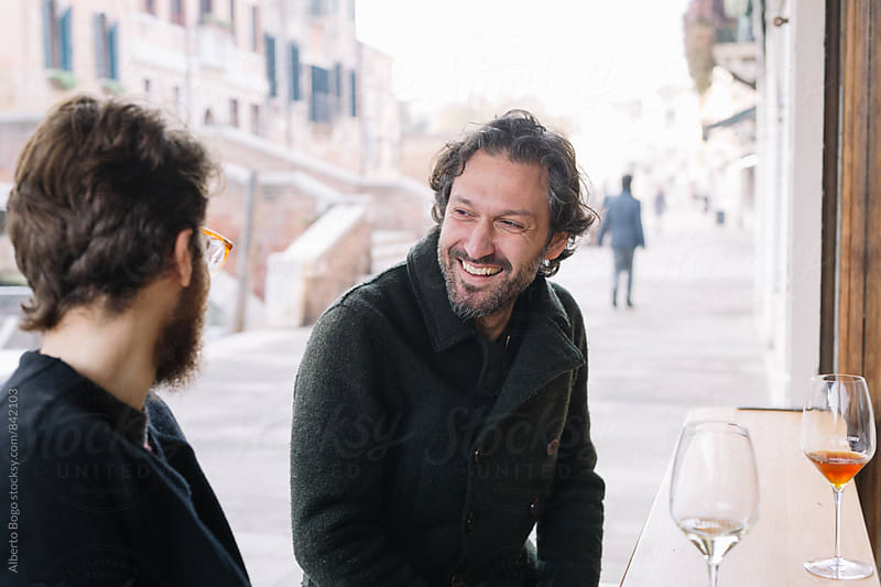 Best Friends drinking wine on the Street by Alberto Bogo for Stocksy United