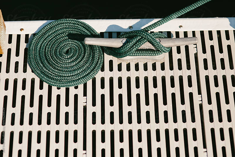 Marine rope coiled on dock by Jeff Marsh for Stocksy United