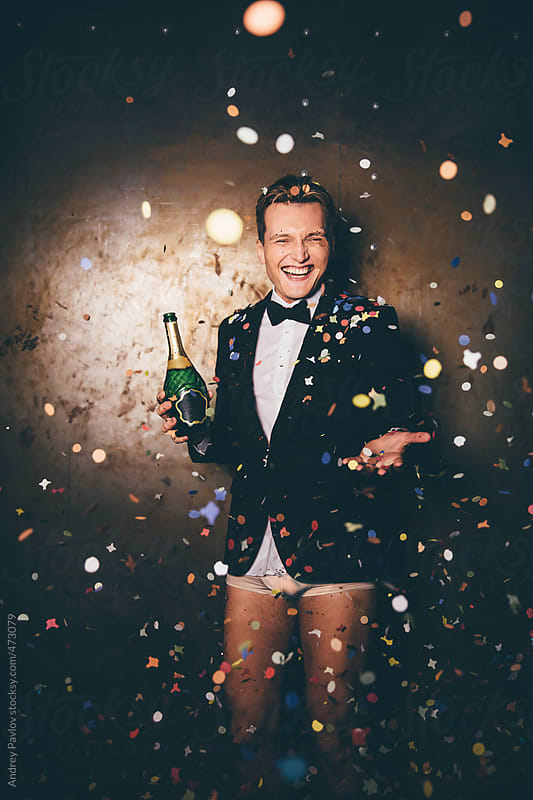 View of a man dressed in a suit and underpants through confetti by Andrey Pavlov for Stocksy United