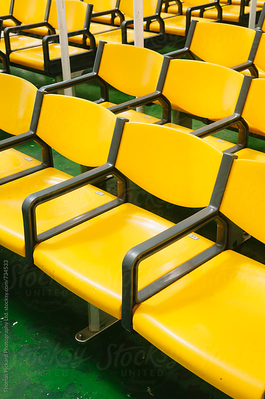 Yellow chairs on inter island ferry Samoa. by Thomas Pickard for Stocksy United