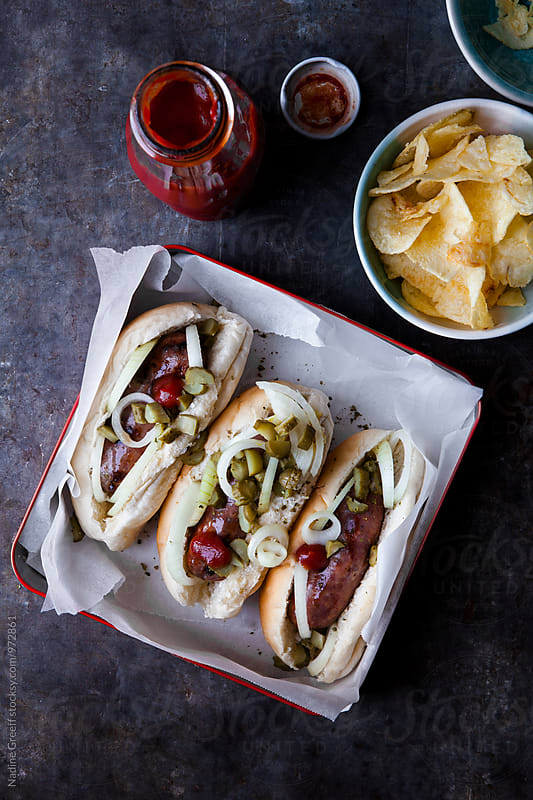 Hot dogs with ketchup  by Nadine Greeff for Stocksy United