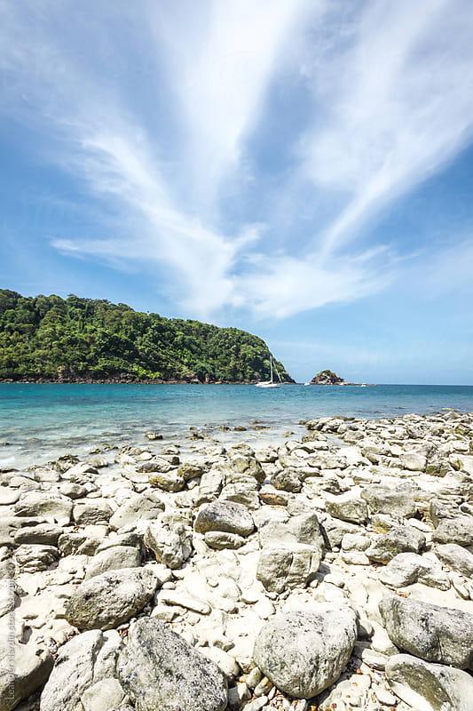 lonesome rocky beach by Leander Nardin for Stocksy United
