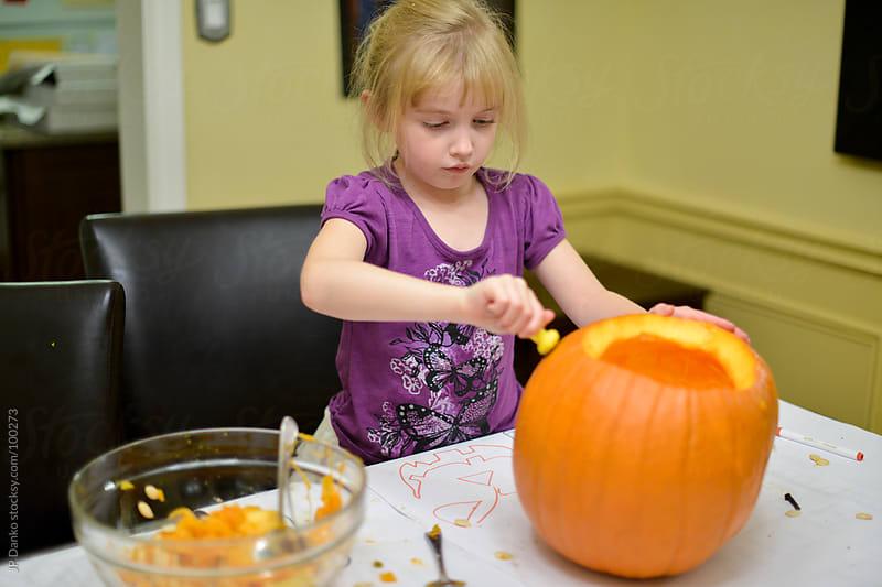 Little Girl Carving Halloween Jack-O-Lantern by JP Danko for Stocksy United