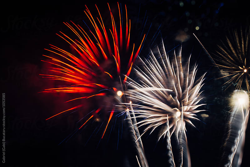 Red and white fireworks by Gabriel (Gabi) Bucataru for Stocksy United