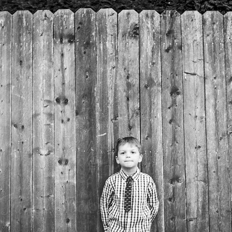 Fence Portrait  by Cameron Whitman for Stocksy United
