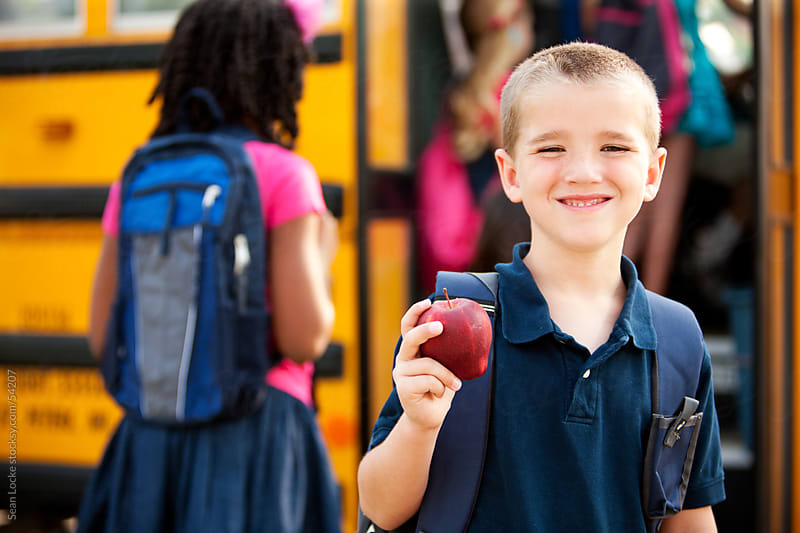School Bus: Boy Brings Apple For Teacher by Sean Locke for Stocksy United