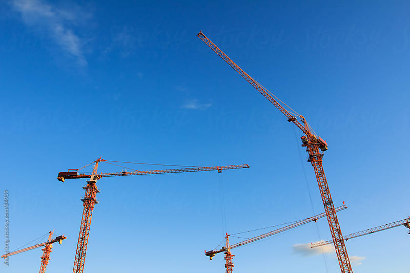 tower crane  at a construction site by zheng long for Stocksy United