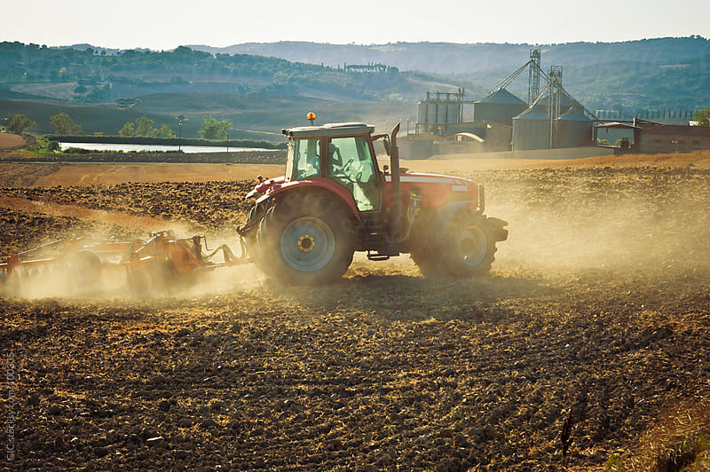 Tractor in Action on A Dry Field by GIC for Stocksy United