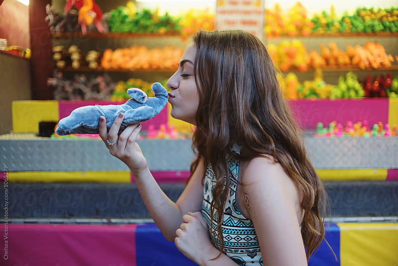 A girl winning a prize at a carnival by Chelsea Victoria for Stocksy United