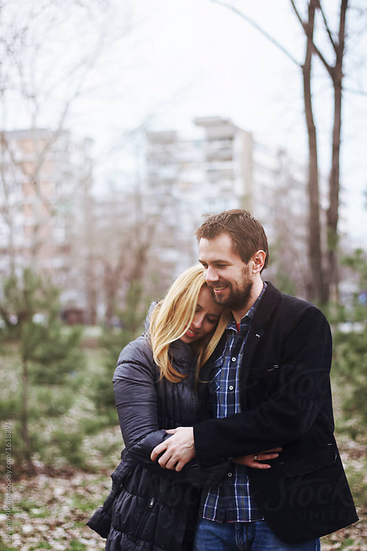 Hugged couple in a park by Jovana Rikalo for Stocksy United