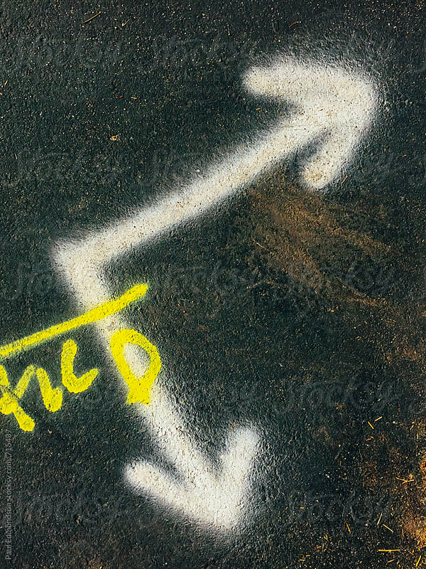 Painted arrow symbol of urban street, close up by Paul Edmondson for Stocksy United