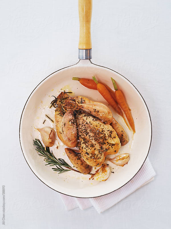 Cooking Chicken Dinner by Jill Chen for Stocksy United