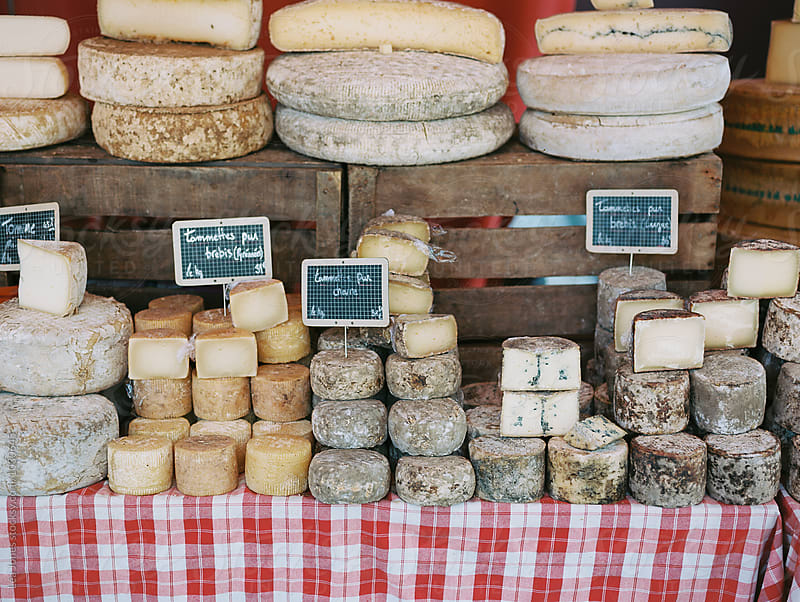 cheese on a French market market by Léa Jones for Stocksy United