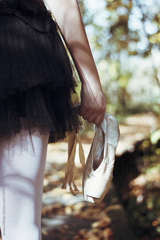 Ballerina holding her ballet shoes  by Jovana Rikalo for Stocksy United